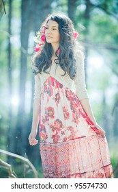 Young Girl in Red Flowery Dress in Enchanted Forest