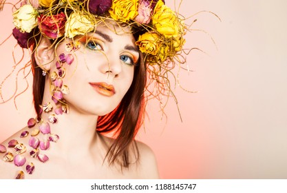 Young girl with red rose petals on her head in hairs