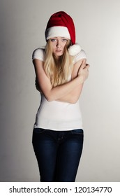 young girl in red santa hat freezing