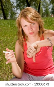 Young girl refusing a cigarette