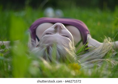 a young girl relaxing in the grass