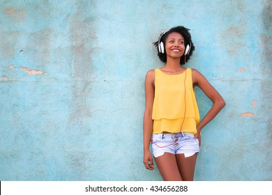 young girl relaxing listening music with her headphones