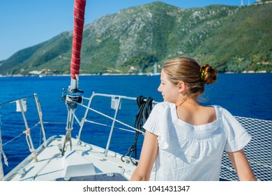 Young girl relaxing On Yacht in Greece