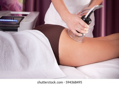 Young girl is relaxing in the spa. Body massage.Legs massage.