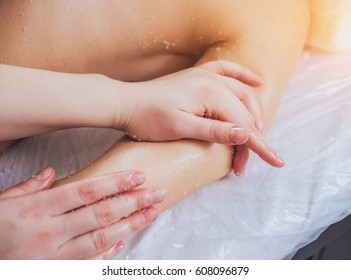 Young girl is relaxing in the spa. Body massage.