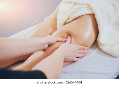 Young girl is relaxing in the spa. Legs massage.