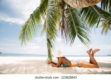 Young girl resting on a paradise beach