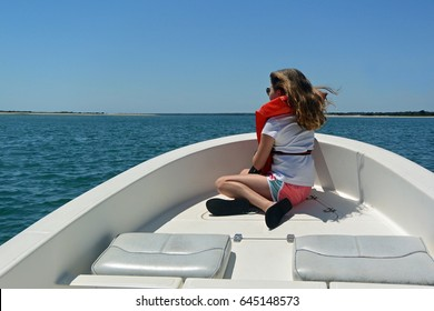 Young girl riding on a speedboat