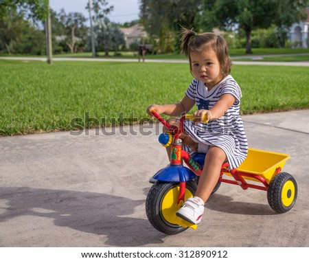 Young girl rides toy