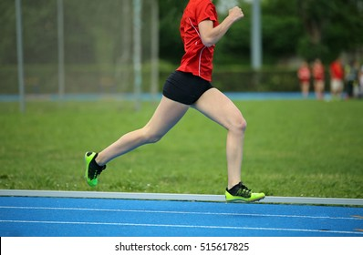 young girl runs faster on the track during a sports competition