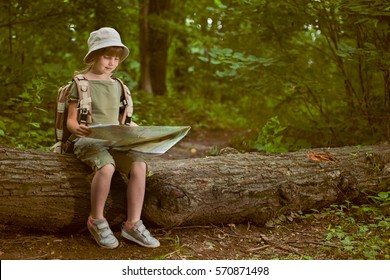 young girl scout, explores  nature on camping trip