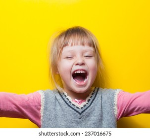 Young girl screaming with arms out, feet spread