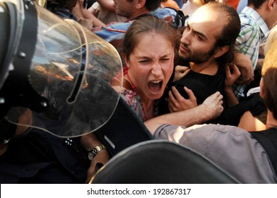 Young girl screaming in front of a police riot, during the ecological protest against construction work at the Bulgarian sea coast - Sofia, Bulgaria - 14, June 2012