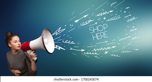 Young girl screaming to megaphone with SHOP HERE inscription, shopping concept