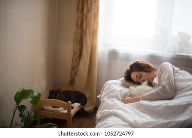 young girl and seals sleep in the morning