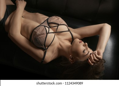 Young girl in sexy underwear lying on the sofa