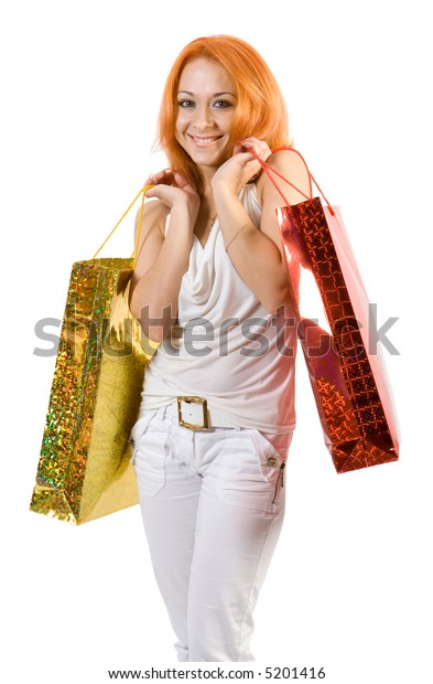 Young girl with shopping bags. Isolate on white background.