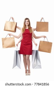 Young girl with shopping bags on white background