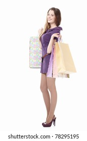 Young girl with shopping bags on a white background