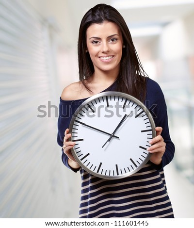 Young Girl Showing Clock, Indoor