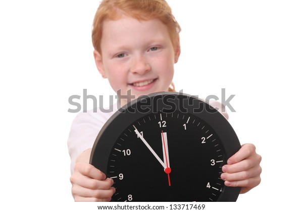 Young girl showing a clock on white background
