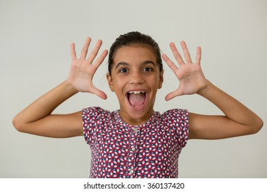 Young girl showing palms screaming