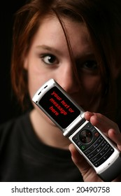 Young girl showing phone
