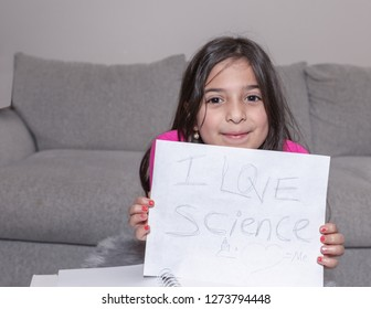 A young girl is showing a pride of science loving