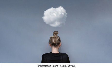 Young girl simple hairstyle back view with cloud above her head. Depression, loneliness and quarantine concept. Fashion model, trendy woman. Mental health metaphor concept