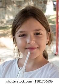 Young girl sipping her juice