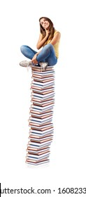 young girl sitting on a books tower isolated on white