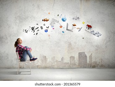 Young girl sitting on chair with icon flying above