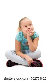 A young girl is sitting in studio, isolated on white background