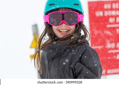 Young girl with ski mask and helmet.