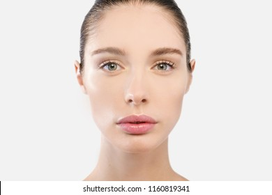 young girl with skin and perfect features shows clean and moisturized skin. concept of creams of beauty and anti-aging, purity and creams for the treatment of wrinkles