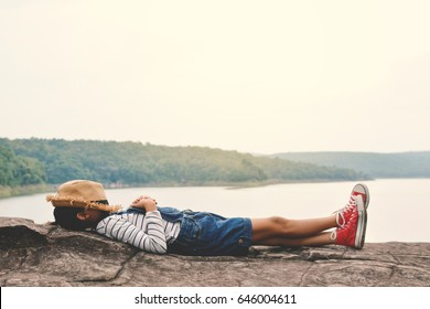 Young girl sleep in the park on nature, Relax time on holiday concept travel ,color of hipster tone