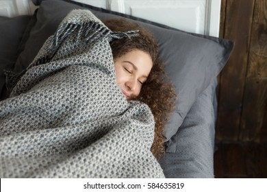 Young girl sleeping in the bed alone