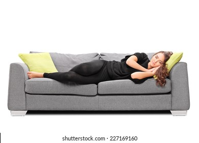Young girl sleeping on a sofa isolated on white background