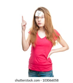 Young girl with small note paper on her forehead. Inspiration or idea concept. Looking into the camera, holding her hand with finger up. Isolated on white background.