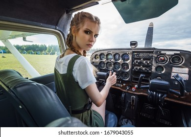 Young girl with small white aircraft