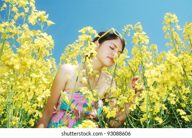 A young girl smelling the flowers of spring