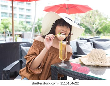 Young girl smile enjoy and happy to drinking her cocktail
