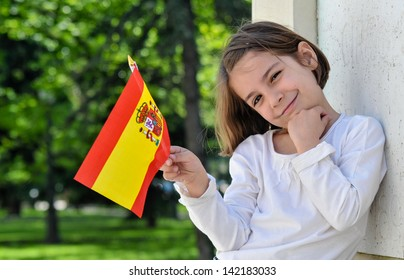 A Young Girl With Spanish Flag