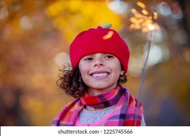 Young girl with sparkler firework