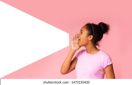 Young girl speaking loud aside to imaginary amplifier holding hand near her open mouth. Side view with empty space