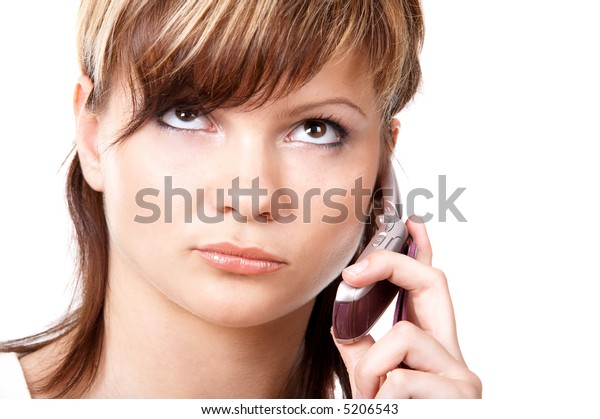 Young girl speaking on the telephone isolated at the white background