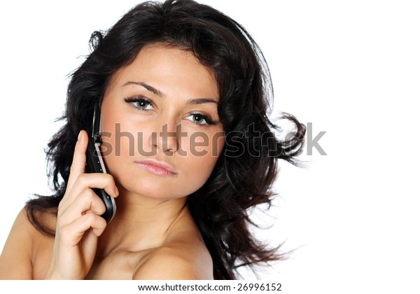 The young girl speaks by phone
