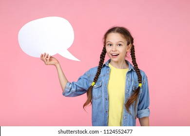 Young girl with speech bubble on pink background