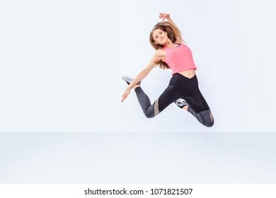 a young girl in sport dress by dancing aerobics or fitness or zumba exercise