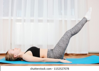 Young girl is sporting gymnastic mate. Concept home training.